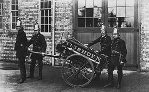 Firemen with the hose cart